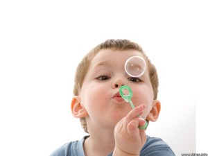 child-playing-with-bubbles